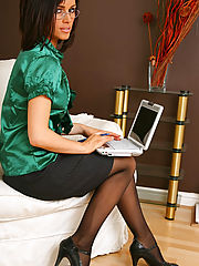 Sex Office, Sexy brunette secretary Gemma Massey relaxes on her sofa in nothing but gorgeous opaque pantyhose