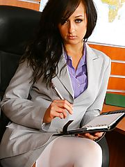 Hardcore Office, Beautiful brunette secretary Laura A strips from her cute grey suit and purple shirt to give us a glimpse of her sexy white lingerie