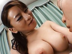 Rei Kitajima exposes her tits to her young lover in this video